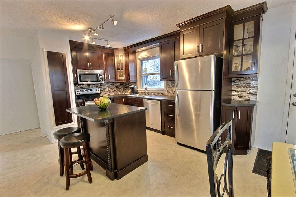 5211 118 Avenue, 4 bed, 2 bath, at $349,900