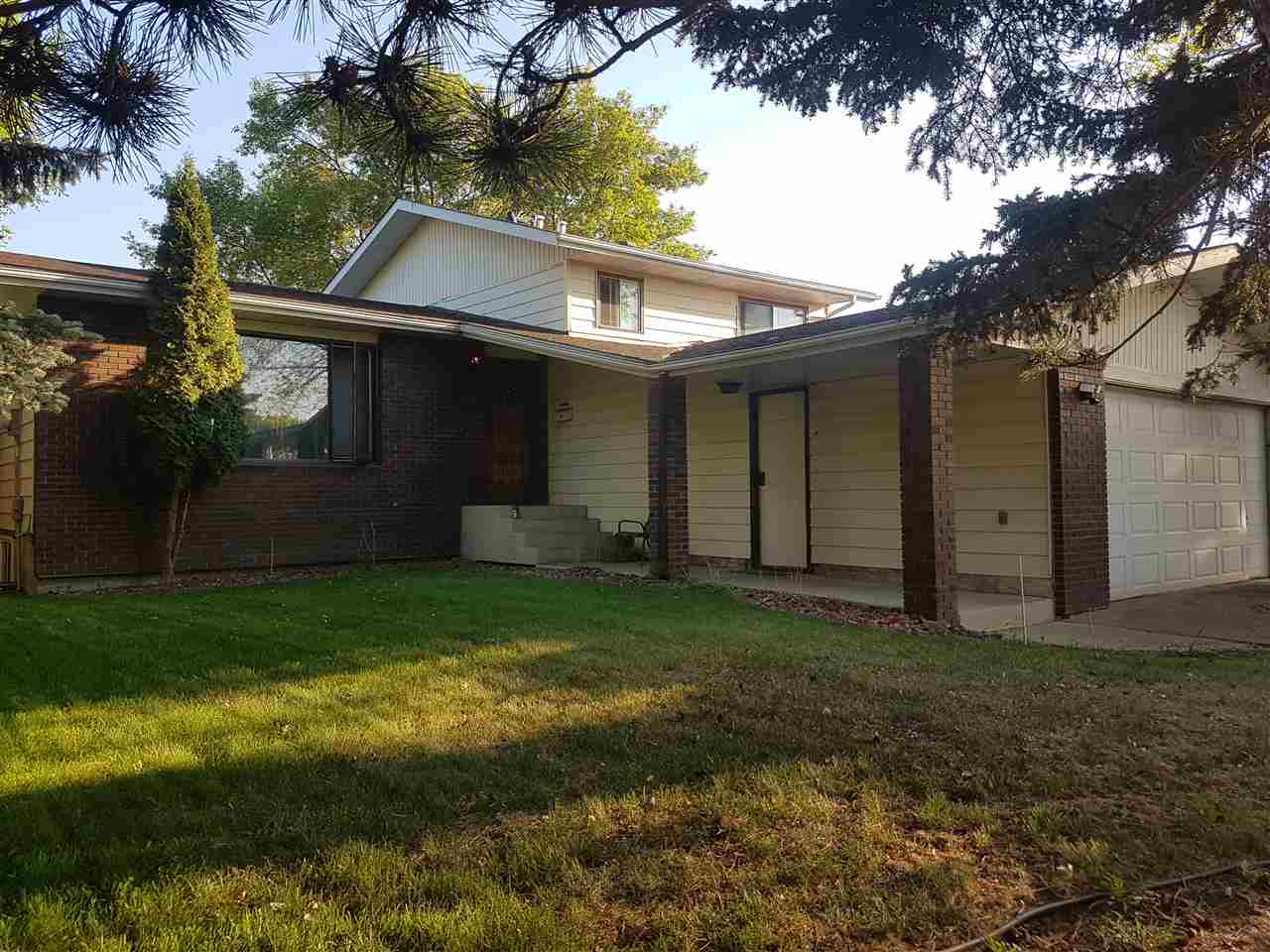 6915 10 Ave, 4 bed, 2.1 bath, at $399,000